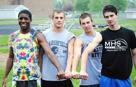 The Marshfield boys 400-meter relay team of Keiron Howlett, left, Ryan Trierweiler, Riley Gebelein and Olin Boson will compete at the WIAA State Track and Field Meet on Friday and Saturday at the University of Wisconsin-La Crosse. Howlett also wlll compete in three individual events. (Photo by Paul Lecker/MarshfieldAreaSports.com)