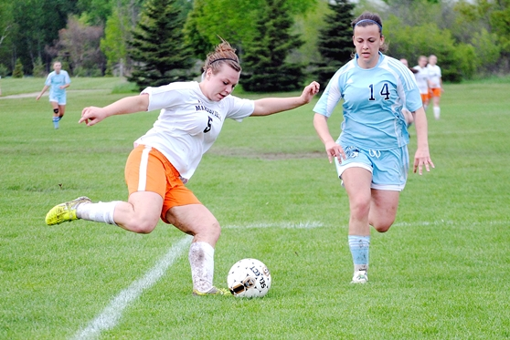 Marshfield's Darian Molter scores from long distance in front of Superior's Jaydeen Anderson during the first half of the Tigers' 7-1 win in a WIAA Division 1 girls soccer regional semifinal Thursday at Griese Park in Marshfield. (Photo by Paul Lecker/MarshfieldAreaSports.com)