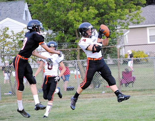 Marshfield safety Daulton Varsho intercepts a pass during the Tigers' Family Night on Thursday at Beell Stadium. (Photo by Paul Lecker/MarshfieldAreaSports.com)