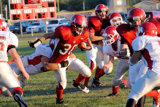 Spencer/Columbus running back Tyler Voda tries to break a tackle inside the Neillsville 5-yard line during Friday's game at Spencer. (Photo by Paul Lecker/MarshfieldAreaSports.com)