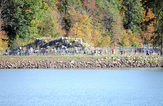 Runners circle the Upper Pond at Wildwood Park during the Marshfield Elementary School One-Mile Fun Run on Tuesday. (Photo by Paul Lecker/MarshfieldAreaSports.com)