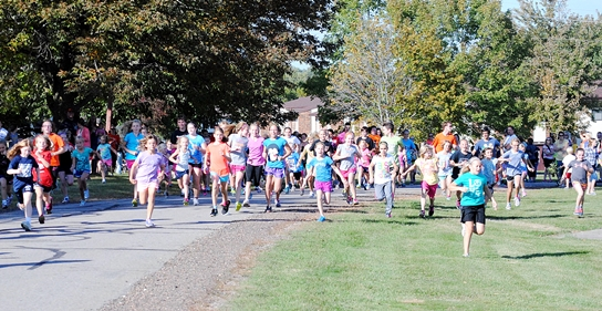 The 112 girls participating in the Marshfield Elementary School One-Mile Fun Run on Tuesday get started. (Photo by Paul Lecker/MarshfieldAreaSports.com)