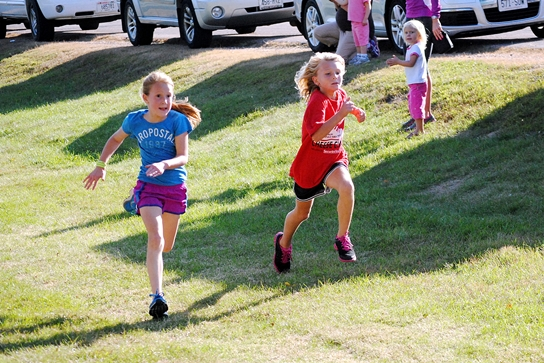 Two girls sprint to the finish during the Marshfield Elementary School One-Mile Fun Run on Tuesday at Wildwood Park. (Photo by Paul Lecker/MarshfieldAreaSports.com)