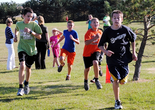 A group of boys round the corner toward the finish during the Marshfield Elementary School One-Mile Fun Run on Tuesday at Wildwood Park. (Photo by Paul Lecker/MarshfieldAreaSports.com)