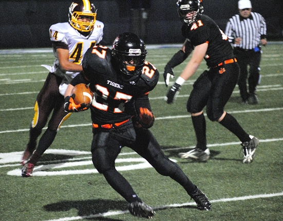 Marshfield running back Caleb Alexander gets to the outside during Friday's WIAA Division 2 Level 1 playoff game at Menomonie. Alexander ran for 101 yards in the Tigers' 7-3 loss. (Photo by Paul Lecker/MarshfieldAreaSports.com)