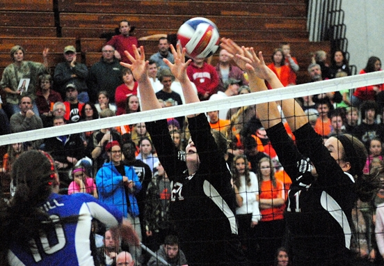 Marshfield's Miranda Forrest, left, and Jordan Green go up to block the spike of Merrill's Lauren Hojan during Saturday's WIAA Division 1 regional final Saturday at Marshfield High School. (Photo by Paul Lecker/MarshfieldAreaSports.com)