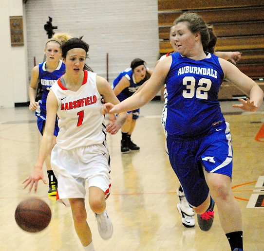 Auburndale's Shannon Yahnke, right, defends Marshfield's McKayla Scheuer during the first half of Friday's game at The Boson Company Fieldhouse at Marshfield High School. Marshfield won 52-39 to advance to the championship game of the Marshfield Tiger Holiday Tournament. (Photo by Paul Lecker/MarshfieldAreaSports.com)
