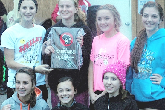 The Stratford girls cross country team celebrates its second-place and state-qualifying finish last Friday at the WIAA Division 3 sectional at Athens. Team members are, in back from left to right, Sammy Griesbach, Gabby Leonhard, Samantha Kaiser and Bailey Bohman. In front, Kaylee Hollatz, Courtney Krall and Johnelle Miner. (Submitted photo)