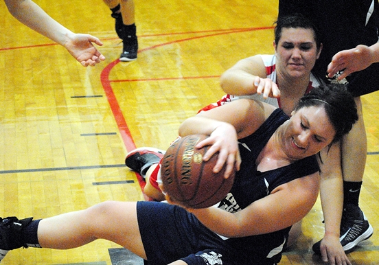 Columbus Catholic's Tara Brock secures a loose ball during the Dons' win over Spencer on Friday night at Spencer High School. (Photo by Paul Lecker/MarshfieldAreaSports.com)