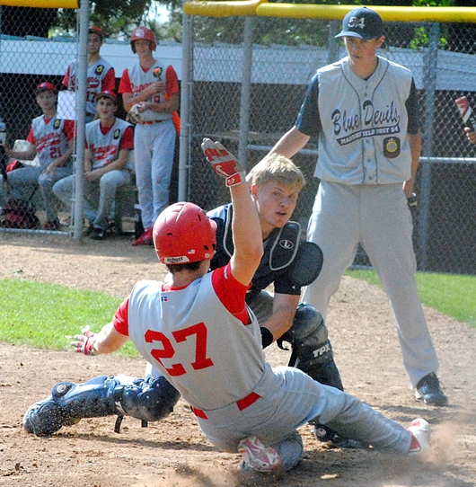 Marshfield Post 54 catcher Nolan Matson tags out Wisconsin Rapids' A.J. Weiss to end the first inning during Tuesday's Legion regional game at Bukolt Park in Stevens Point. Marshfield pitcher Jeremy Binder is backing up the play. (Photo by Paul Lecker/MarshfieldAreaSports.com)