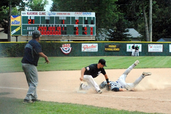 Marshfield Post 54's Nolan Matson slides safely into third base after ripping a two-run triple during the ninth inning of the Blue Devils' 7-1 win over Plover on Friday at Bukolt Park in Stevens Point. Plover came back to beat Marshfield 8-3 in the second game to advance to next week's state tournament. (Photo by Paul Lecker/MarshfieldAreaSports.com)