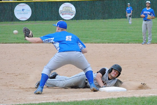 Marshfield's Mason Metz dives safely back into first base after a pickoff attempt during a WIAA Division 1 baseball regional semifinal Tuesday at Jack Hackman Field in Marshfield. The Tigers won 10-2. The Merrill first baseman is Christian Kleinschmidt. (Photo by Paul Lecker/MarshfieldAreaSports.com)