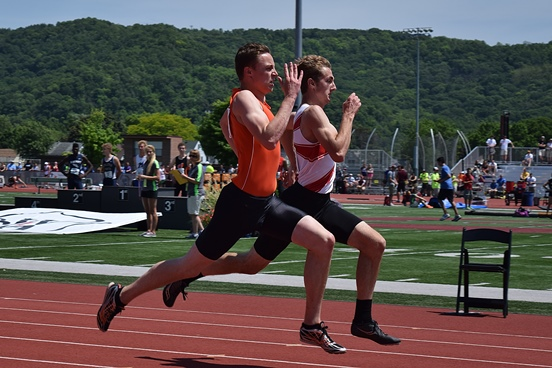 Marshfield's Calden Wojt battles in the Division 1 boys 200-meter preliminaries at the WIAA State Track & Field Championships on Friday at the University of Wisconsin-La Crosse. Wojt qualified fourth in the event and will run in the finals on Saturday. (Photo courtesy of Eric LeJeune/Hub City Times)