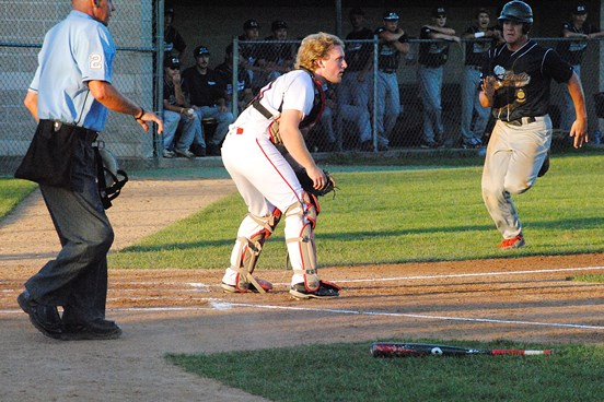 Marshfield Post 54's Hunter Luepke barrels in toward home plate and beats the throw to score a run during the first inning of Tuesday's game against Sheboygan in a Class AAA State Legion baseball tournament game at Jack Hackman Field in Marshfield. Marshfield won 5-4. (Photo by Paul Lecker/MarshfieldAreaSports.com)