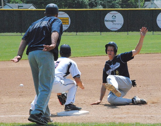 Marshfield Post 54's Trevor Schwecke slides safety into third base during the Blue Devils' 15-3 win over Stevens Point in a Class AAA regional game Tuesday at Jack Hackman Field. (Photo by Paul Lecker/MarshfieldAreaSports.com)