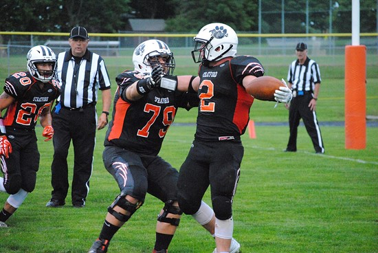 Stratford offensive lineman Tanner Weinfurtner (79) celebrates with Kam Bornbach after Bornbach scored a touchdown during a win over Marathon in August. Both Bornbach and Weinfurtner were first-team all-Marawood Conference choices. (Photo by Paul Lecker/MarshfieldAreaSports.com)