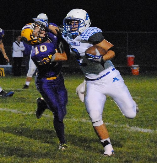 Auburndale running back Collin Hawkins stiff arms a Pittsville defender on his way to a first-down run during Friday night's game at Pittsville High School. The Apaches won 12-8. (Photo by Paul Lecker/MarshfieldAreaSports.com)