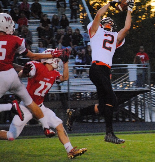 Marshfield wide receiver Nathan McGrath hauls in a pass from Ryan Krueger that turned into a 42-yard touchdown during the first quarter of Friday's game at Wisconsin Rapids. The Tigers lost 21-14. (Photo by Paul Lecker/MarshfieldAreaSports.com)