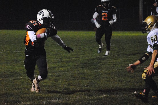Stratford's Jordan Becker eyes up a Colby defender after catching a pass during the Tigers' WIAA Division 5 football playoff win Friday night at Tiger Stadium. (Photo by Paul Lecker/MarshfieldAreaSports.com)