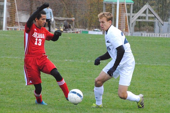 Columbus Catholic's Tyler Fuerlinger, right, dribbles past Arcadia's Jonathan Rodriguez early in a WIAA Division 4 boys soccer sectional semifinal Thursday at Griese Park in Marshfield. Fuerlinger scored three times, but the Dons lost 7-5. (Photo by Paul Lecker/MarshfieldAreaSports.com)
