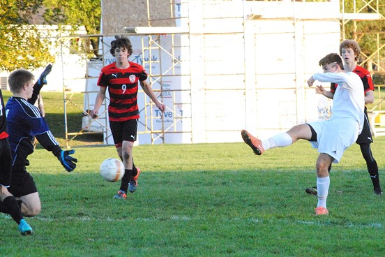 Marshfield's Ethan Leischow boots home the game-winning goal in the 85th minute as the Tigers beat Pulaski 1-0 in a WIAA Division 2 boys soccer regional final Saturday at Griese Park in Marshfield. (Photo by Paul Lecker/MarshfieldAreaSports.com)