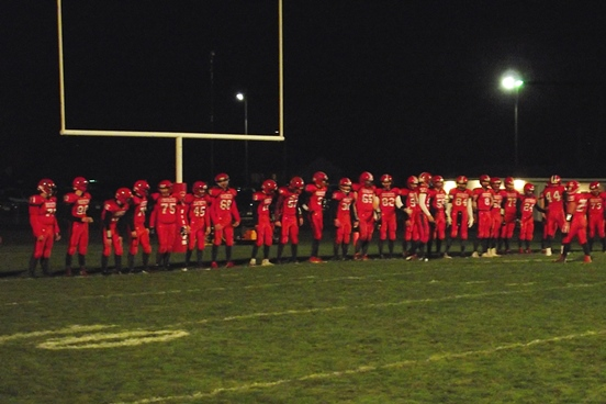 The Spencer/Columbus football team lines up for introductions prior to its game against Bonduel on Friday night at Spencer High School. (Photo by Steve Pilz/For MarshfieldAreaSports.com)