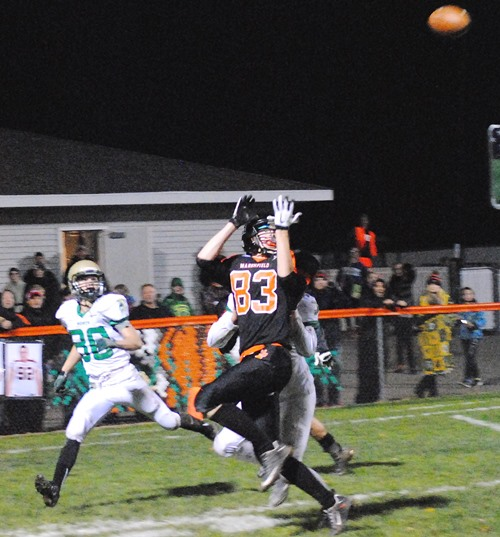 Marshfield's Zackary Schmidt attempts to haul in a pass in the end zone during the Tigers' loss to Oshkosh North on Friday night at Beell Stadium in Marshfield. The pass was broken up by a Spartans' defender. (Photo by Paul Lecker/Marshfield AreaSports.com)