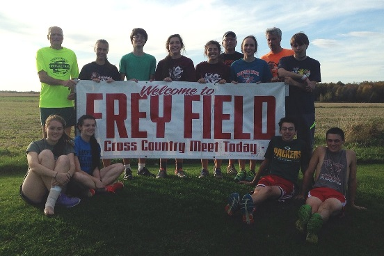 The seniors and coaches of the Marshfield High School cross country team promote the Wisconsin Valley Conference Cross Country Meet, which will be held Saturday at Frey Field in Spencer. Team members and coaches are, in front from left, Karen Scheuer, Taylor Geurink, Noah Behling and Anthony Kanable. In back, coach Christensen, Inge Berg, Sam Donahue, Bailey-Ann Hollatz, Maddie Haessly, coach Dan Akin, Sadie Degrand, coach Weiler, and Kennedy Rowe. (Submitted photo)