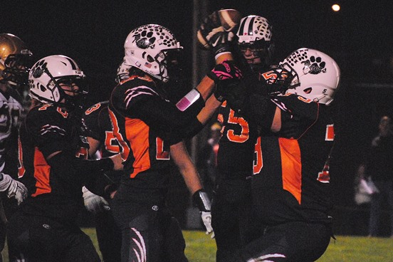 Stratford's Tanner Weinfurtner (far right) holds up the ball after recovering a fumble during the second quarter of the Tigers' WIAA Division 5 football playoff win against Colby on Friday at Tiger Stadium in Stratford. (Photo by Paul Lecker/MarshfieldAreaSports.com)