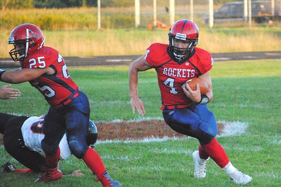Spencer/Columbus junior Hunter Luepke carries the ball during a game earlier this season against Stanley-Boyd. Luepke was named to the All-North Central Region football team at both running back and inside linebacker by the Wisconsin Football Coaches Association. (Photo by Paul Lecker/MarshfieldAreaSports.com)