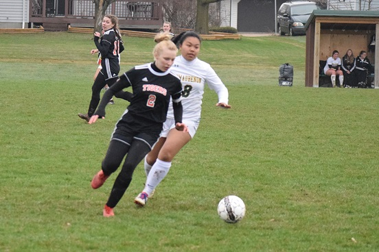 a12cc6cc6b9 Marshfield defender Ana Paape chases down a ball in the back end during the  second half of the Tigers  4-0 win over Ashwaubenon on Monday at Griese  Park.